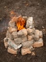Mud brick being heated as part of the preparation for a Kung You, a traditional Taiwanese harvest celebration, Taichung, Central Taiwan